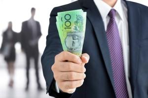 businessman hand holding money, australian dollar banknotes