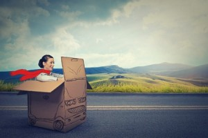 lady-driving-in-a-speeding-in-cardboard-box