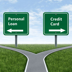 two signs at a fork in the road indicating personal loan or credit card