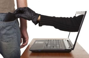 Arm reaching out from a laptop to steal money from a pocket