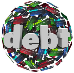 Debt shown in 3d letters on a ball or sphere of credit cards to illustrate being behind in bills paying off money owed, bankruptcy or financial hardship