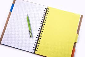Open notebook with a pen lying