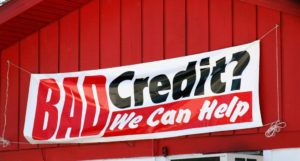 bad credit banner hung on the front of a barn