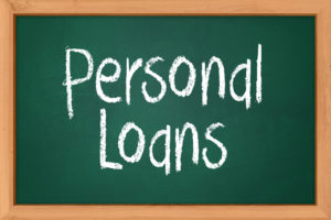 personal loans written on a blackboard