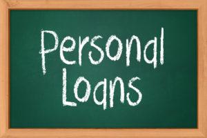 personal loans written on a blackboard