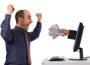 man excited about cash coming out of a computer monitor