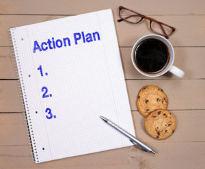 preparing a plan of action in a notebook