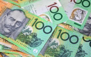 centrelink approved loans - many australian $100 notes spread out