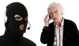 A hooded phone scammer to trying to rip off an old lady