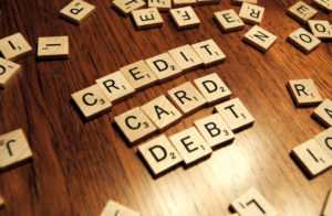 centrelink approved loans - credit card debt spelled out with scabble tokens