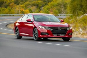 online loans for centrelink customers - New red honda sedan being driven on a highway