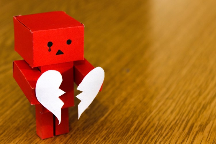centrelink-approved-loans-card-board-cut-out-person-holding-a-broken-heart