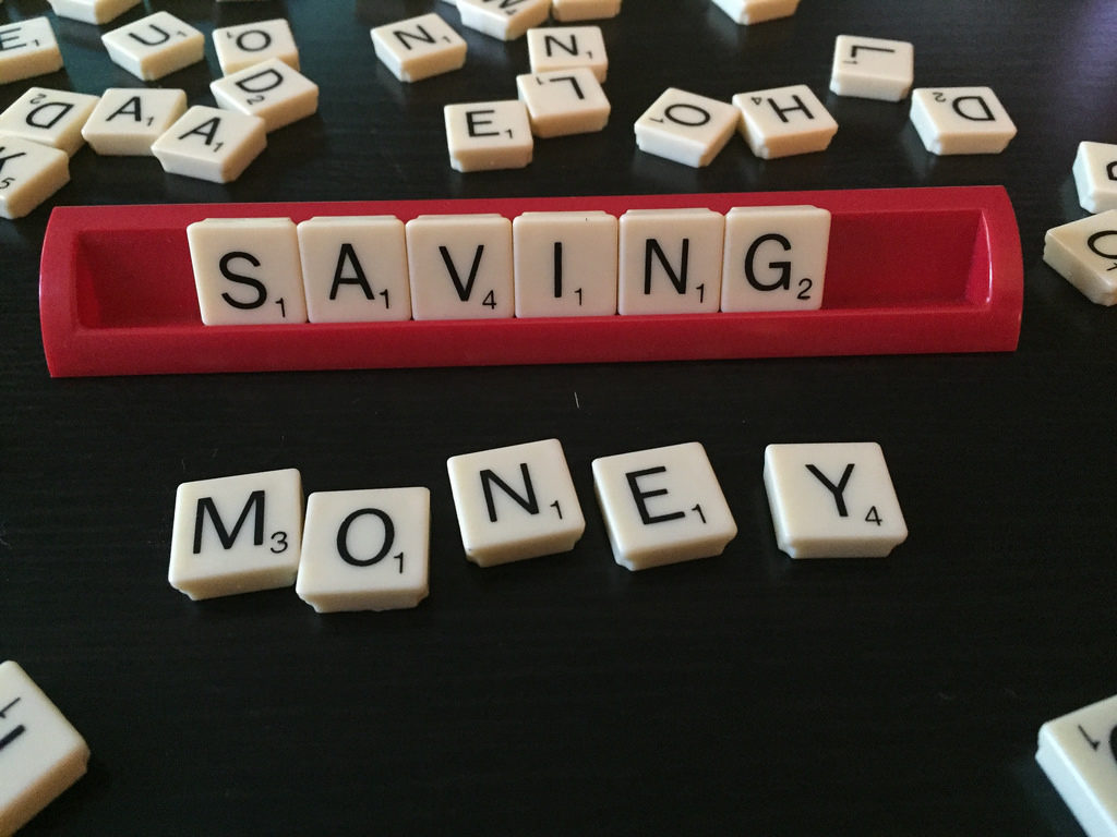 online loans for centrelink customers -saving money spelled out with scrabble tokens