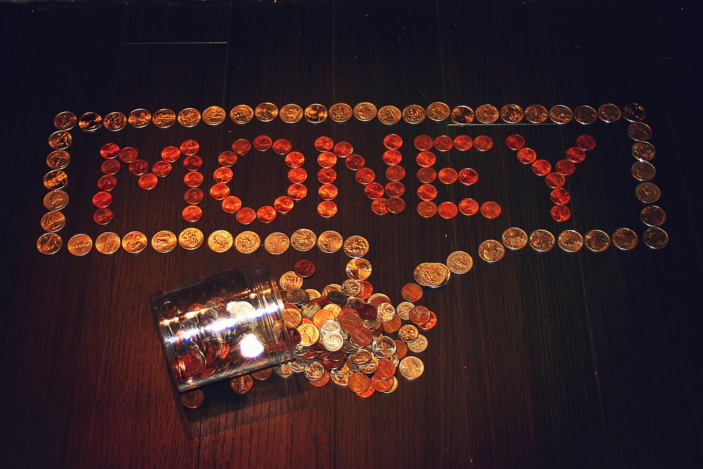 smart money management tips shows the word money spelled out with coins